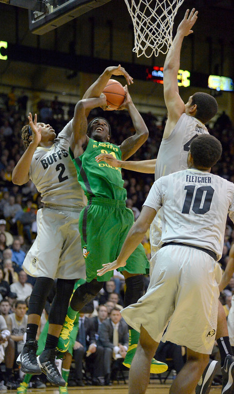. Oregon Ducks guard Damyean Dotson (21) gets his shot blocked by Oregon Ducks forward Arik Armstead (2) during the first half January 5, 2014 at Coors Events Center. (Photo by John Leyba/The Denver Post)