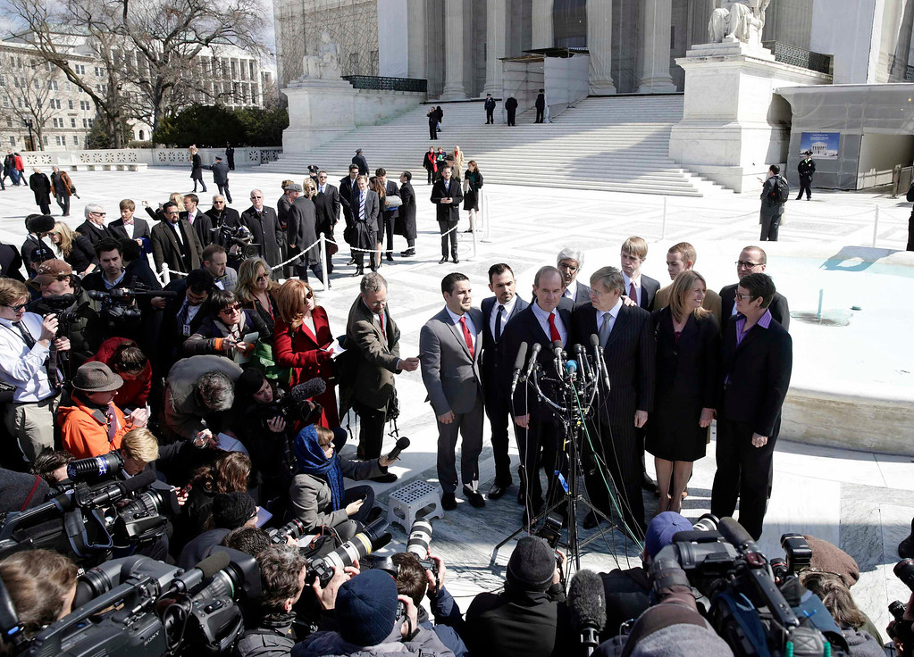 . Attorneys David Bois (front L) and Ted Olson (front R), who argued against the California law Proposition 8, plaintiffs Sandy Stier (2nd R), Kris Perry (R), Paul Katami (L) and Jeff Zarrillo (2nd L) arrive to speak to the media after arguing their case before the Supreme Court in Washington March 26, 2013.     REUTERS/Joshua Roberts