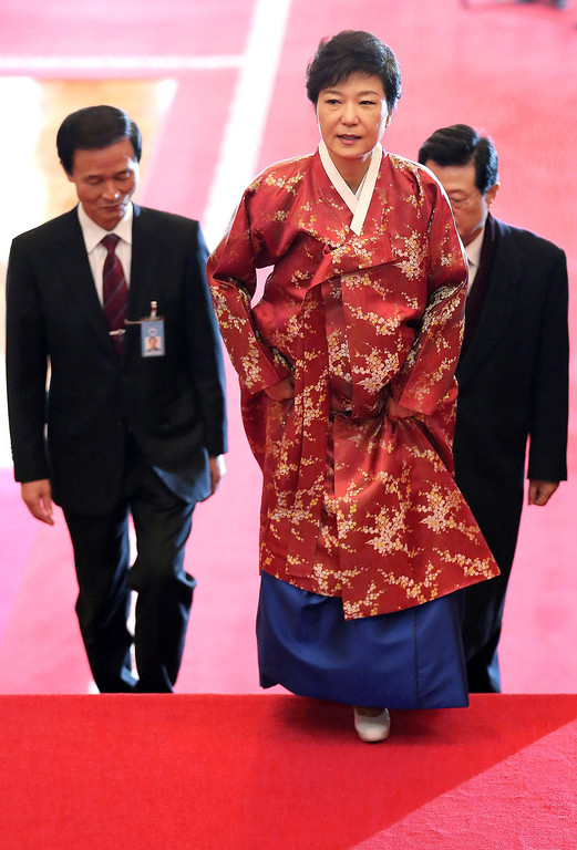 . South Korean new President Park Geun-hye wearing a traditional dress arrives at the presidential house after her inauguration ceremony as the 18th South Korean President in Seoul, South Korea, Monday, Feb. 25, 2013.  (AP Photo/Yonhap, Jin Sung-chul)