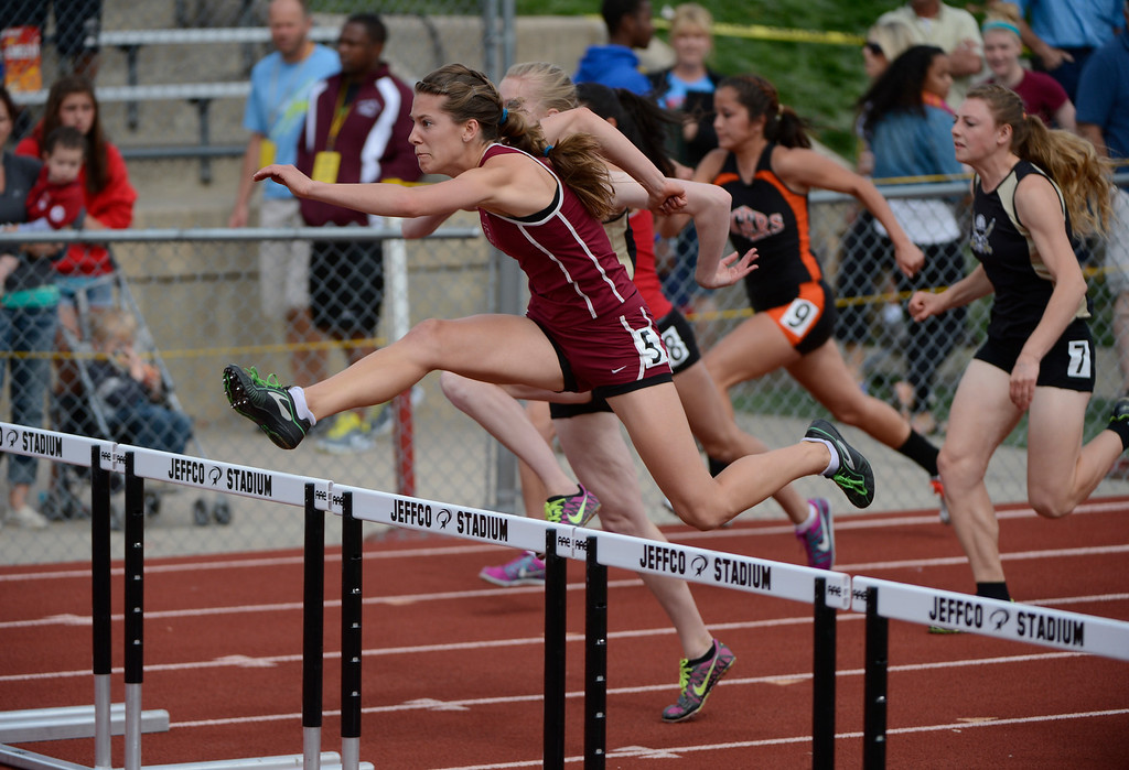 . LAKEWOOD, CO - MAY 18: Alexa Chacon, left, The Classical Academy,  heads to victory during the girls 5A 100 meter hurdles final at the Colorado State Track and Field Championships at Jeffco Stadium, Saturday morning, May 18, 2013. Chacon won with a time of 14.23.  (Photo By Andy Cross/The Denver Post)