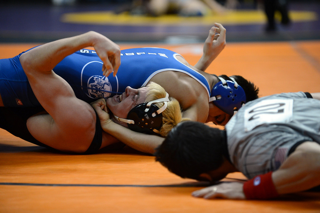 . DENVER, CO. - FEBRUARY 22: Sonny Espionza of Pueblo Central High School, top, pins Travis Myers of Pueblo West High School during the 132 pound class of 4A State Championship semifinal match at Pepsi Center February 22, 2013. Denver, Colorado. (Photo By Hyoung Chang/The Denver Post)