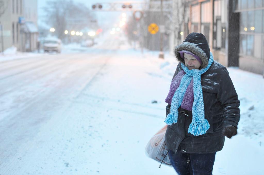 . Susan Miller of Windber, Pa. walks during the snow storm on Tuesday, Jan. 21, 2014.   (AP Photo/The Tribune-Democrat, Todd Berkey)