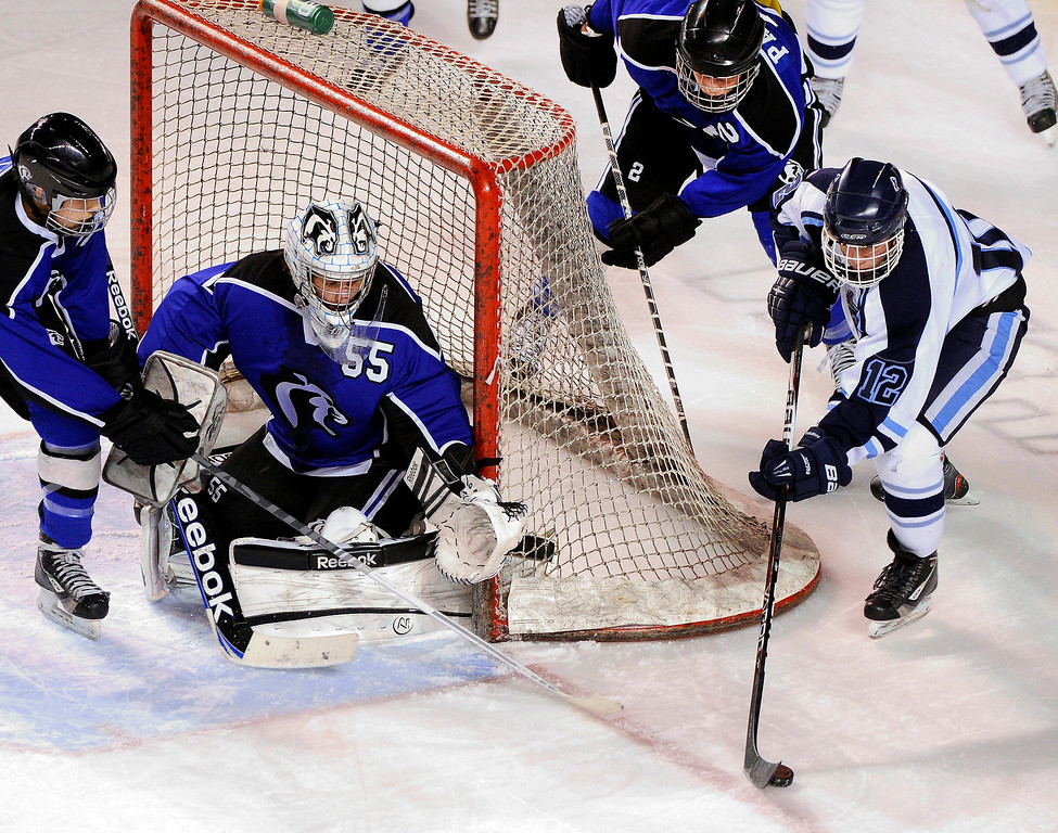 . DENVER, CO. - FEBRUARY 28: Mustangs forward Victor Lombardi (12) controlled the puck on the red line in the second period. Ralston Valley High School took on Resurrection Christian Thursday night, February 28, 2013 in a semifinal match in the Colorado State Ice Hockey Championships at Magness Arena in Denver. (Photo By Karl Gehring/The Denver Post)