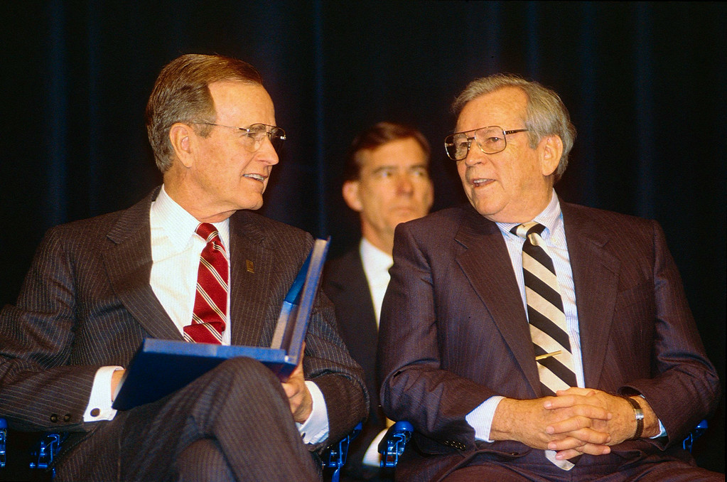 . FILE - In this  Feb. 19, 1992, file photo,  President George H.W. Bush, left, speaks with former U.S. Sen. Howard H. Baker Jr. in Knoxville, Tenn. Baker died Thursday, June 26, 2014,  from complications from a stroke in his hometown of Huntsville, Tenn, at age 88. (AP Photo/Knoxville News Sentinel, File)