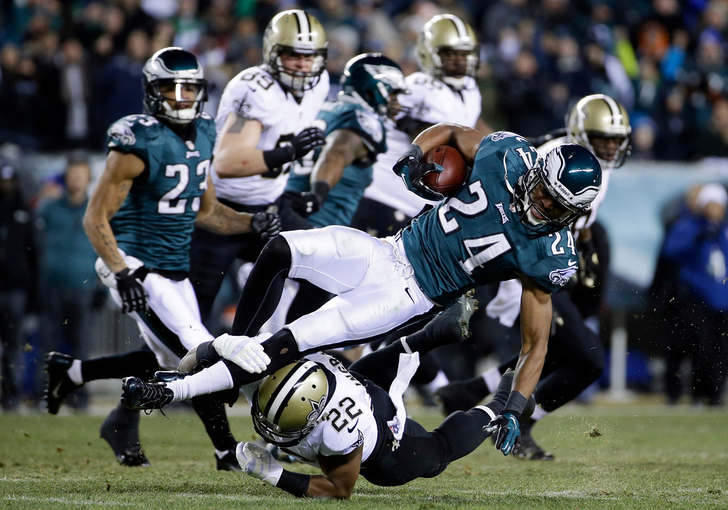 . Philadelphia Eagles\' Bradley Fletcher (24) is tackled by New Orleans Saints\' Mark Ingram (22) after Fletcher intercepted a Saints\' pass during the first half of an NFL wild-card playoff football game, Saturday, Jan. 4, 2014, in Philadelphia. (AP Photo/Matt Rourke)