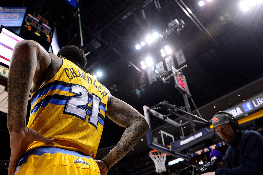. DENVER, CO - MARCH 13: Wilson Chandler (21) of the Denver Nuggets takes a moment during the first half of action. The Denver Nuggets play the New York Knicks at the Pepsi Center. (Photo by AAron Ontiveroz/The Denver Post)