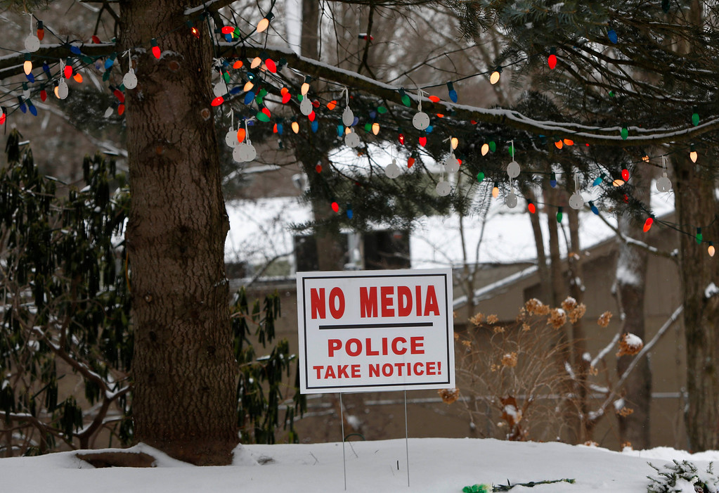 . On the first anniversary of the Sandy Hook massacre, Newtown, Conn., a sign is posted under a Christmas tree, Saturday, Dec. 14, 2013.  Newtown is asking that people honor the victims in ways that are quiet and personal. (AP Photo/Robert F. Bukaty)