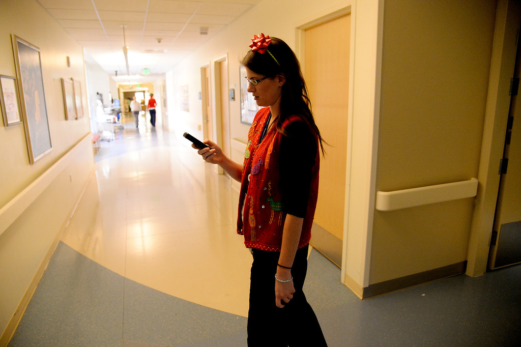 . AURORA, CO - DECEMBER 25: Nurse Sarah Hodgin makes her rounds in holiday garb during her shift in the NICU. Nurses and other hospital staff work on Christmas day at Children\'s Hospital on Wednesday, December 25, 2013. (Photo by AAron Ontiveroz/The Denver Post)