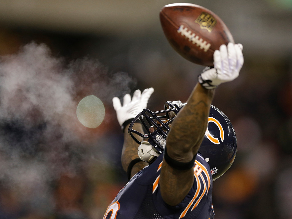 . Chicago Bears wide receiver Earl Bennett (80) celebrates after making a touchdown reception during the first half of an NFL football game against the Dallas Cowboys, Monday, Dec. 9, 2013, in Chicago. (AP Photo/Nam Y. Huh)