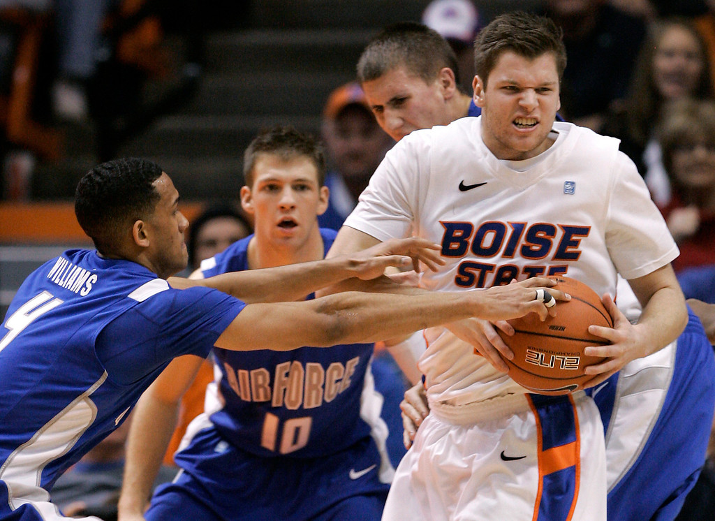 . Boise State\'s Igor Hadziomerovic, right, goes after a loose ball against Air Force\'s Kamryn Williams (4) during the second half of an NCAA college basketball game, Wednesday, Feb. 20, 2013, in Boise, Idaho. Boise State won 77-65. (AP Photo/Matt Cilley)