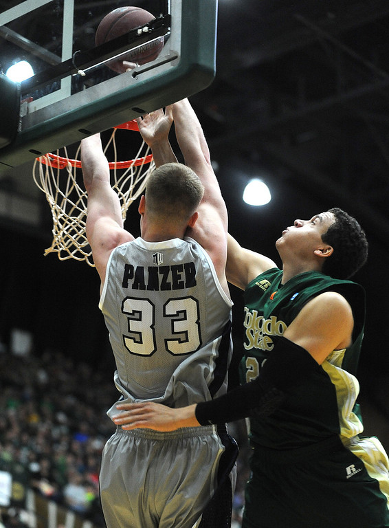 . Nevada\'s Kevin Panzer (33) tries to dunk the ball as Colorado State defender Dorian Green blocks the shot on Saturday, March 9, 2013, during the first half of an NCAA college basketball game at Moby Arena in Fort Collins, Colo. (AP Photo/The Coloradoan, Dawn Madura)