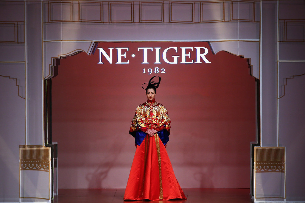 . A model showcases designs by Zhang Zhifeng on the runway at 2014 NE?TIGER Haute Couture Collection show during Mercedes-Benz China Fashion Week Spring/Summer 2014 at Beijing Hotel on October 25, 2013 in Beijing, China.  (Photo by Feng Li/Getty Images)