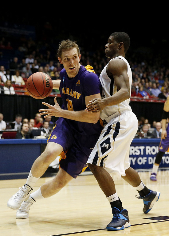 . Luke Devlin #11 of the Albany Great Danes drives against Sam Prescott #3 of the Mount St. Mary\'s Mountaineers in the first half during the first round of the 2014 NCAA Men\'s Basketball Tournament at at University of Dayton Arena on March 18, 2014 in Dayton, Ohio.  (Photo by Gregory Shamus/Getty Images)