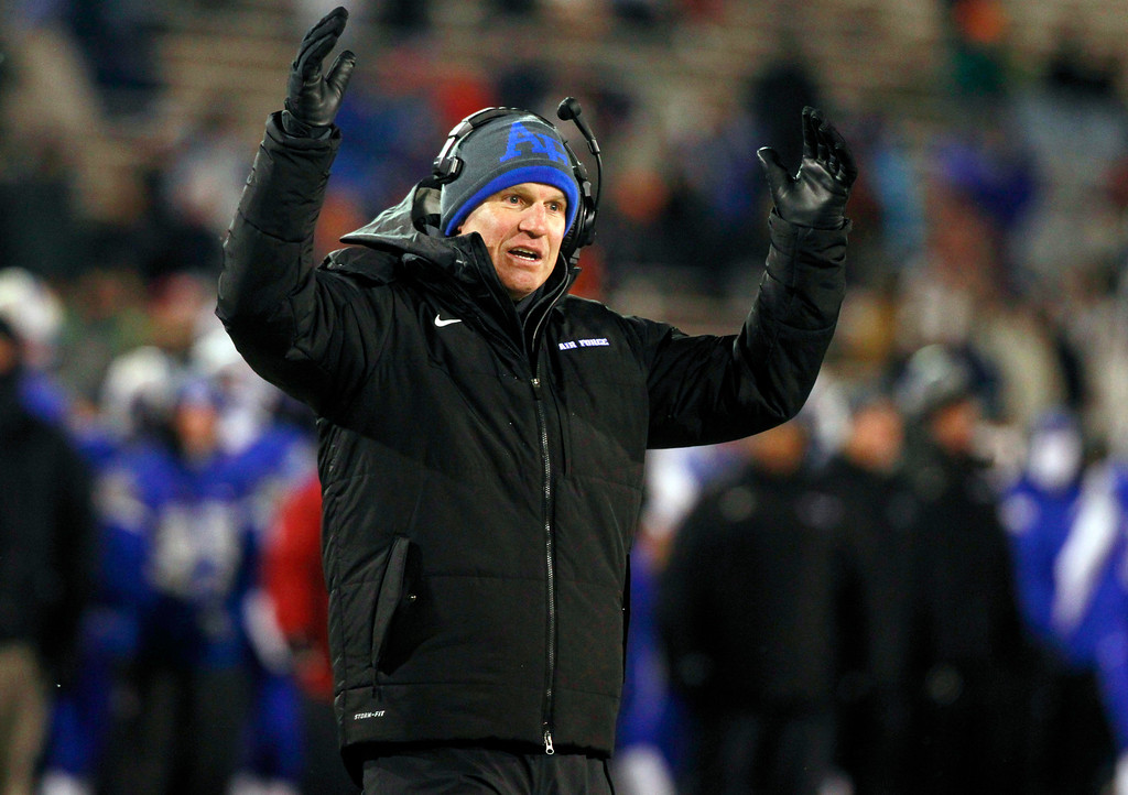 . Air Force head coach Troy Calhoun signals for a touchdown for his team against UNLV in the second quarter of an NCAA football game at Air Force Academy, Colo., on Thursday, Nov. 21, 2013. (AP Photo/David Zalubowski)