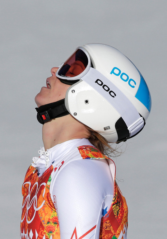 . United States\' Julia Mancuso reacts after finishing the women\'s downhill at the Sochi 2014 Winter Olympics, Wednesday, Feb. 12, 2014, in Krasnaya Polyana, Russia.(AP Photo/Gero Breloer)
