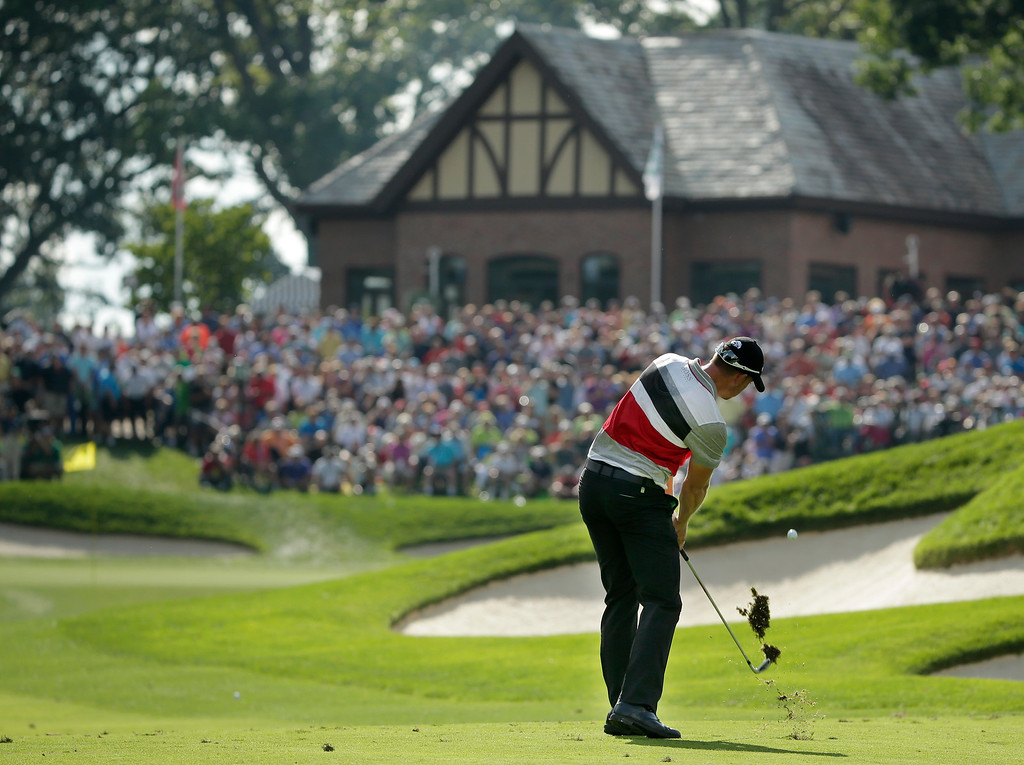 . Henrik Stenson, of Sweden, hits from the fairway on the 13th hole during the second round of the PGA Championship golf tournament at Oak Hill Country Club, Friday, Aug. 9, 2013, in Pittsford, N.Y. (AP Photo/Charlie Riedel)