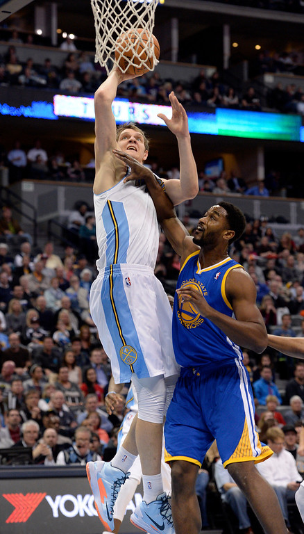 . DENVER, CO - APRIL 16: Denver Nuggets center Timofey Mozgov (25) gets could by Golden State Warriors forward Hilton Armstrong (57) as he goes up for a shot during the first quarter April 16, 2014 at Pepsi Center. (Photo by John Leyba/The Denver Post)