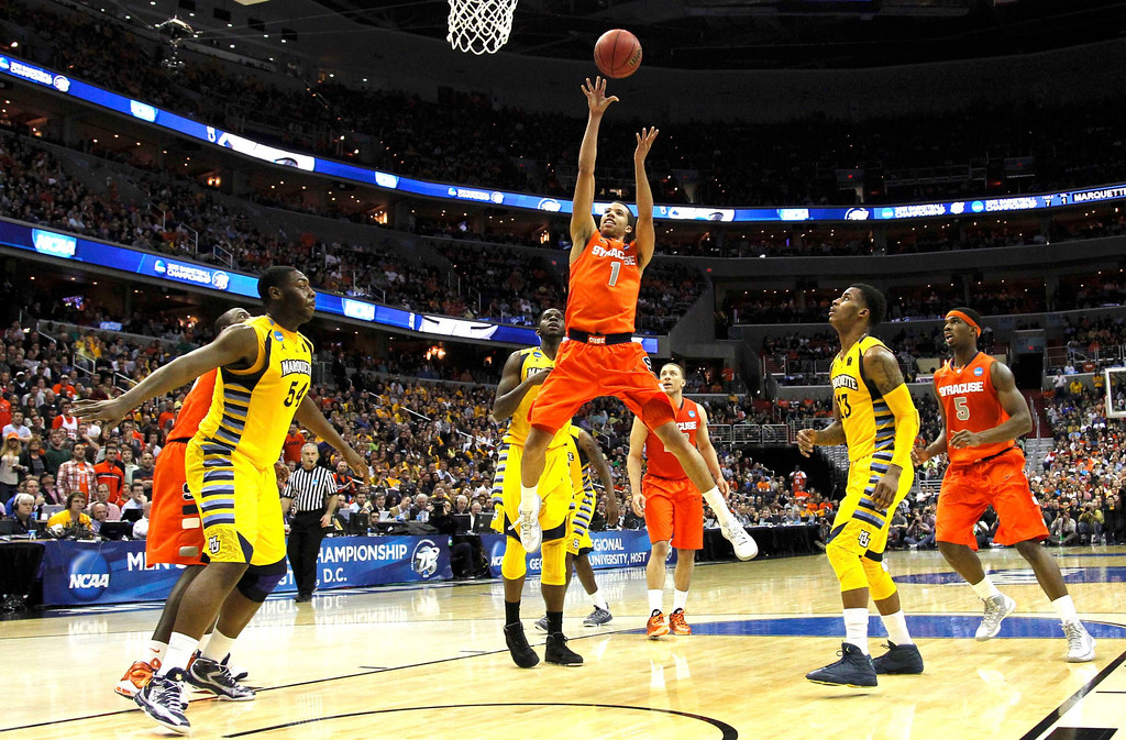 . Syracuse Orange guard Michael Carter-Williams shoots against the Marquette Golden Eagles during the second half in their East Regional NCAA men\'s basketball game in Washington, March 30, 2013. REUTERS/Jason Reed