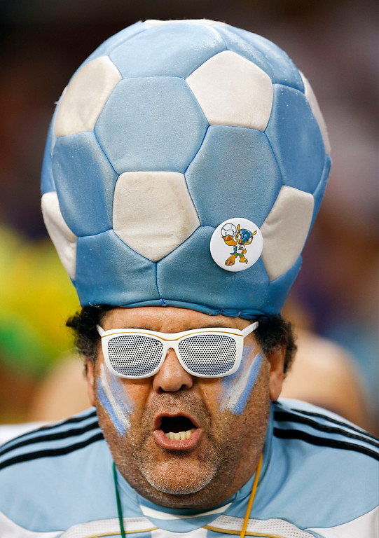 . An Argentine fan wears a soccer ball hat before the group F World Cup soccer match between Argentina and Bosnia at the Maracana Stadium in Rio de Janeiro, Brazil, Sunday, June 15, 2014.  (AP Photo/Kirsty Wigglesworth)