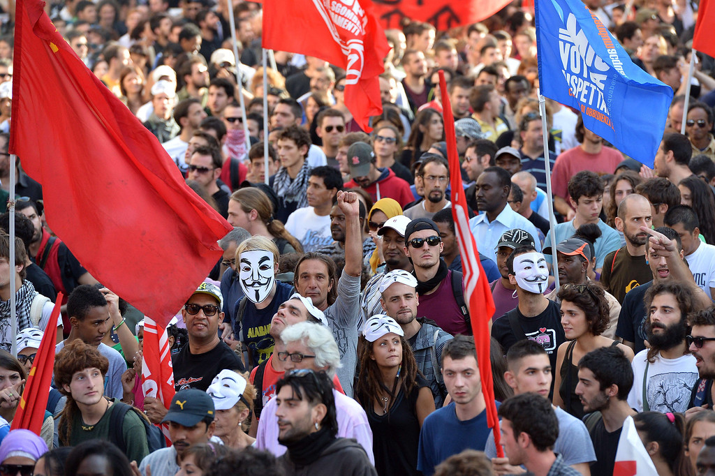 . Thousands of people take part in an anti-austerity protest on October 19, 2013 in Rome. Between 3,000 and 4,000 police officers have been deployed, Italian media reports said, and protest organizers say they expect more than 20,000 to join. ALBERTO PIZZOLI/AFP/Getty Images