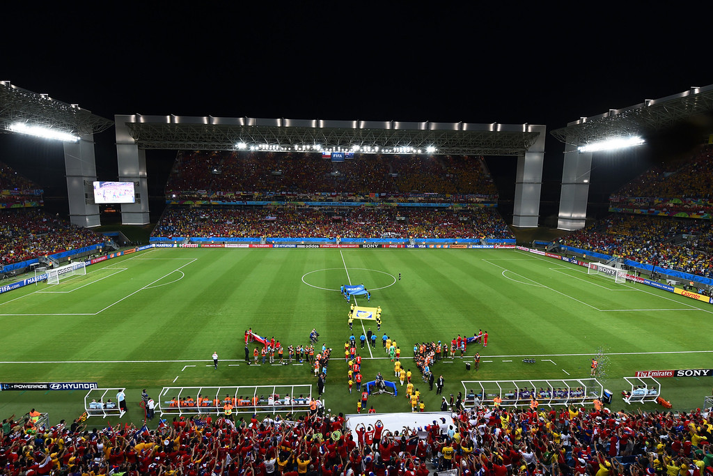 . Chile and Australia take the field during the 2014 FIFA World Cup Brazil Group B match between Chile and Australia at Arena Pantanal on June 13, 2014 in Cuiaba, Brazil.  (Photo by Stu Forster/Getty Images)