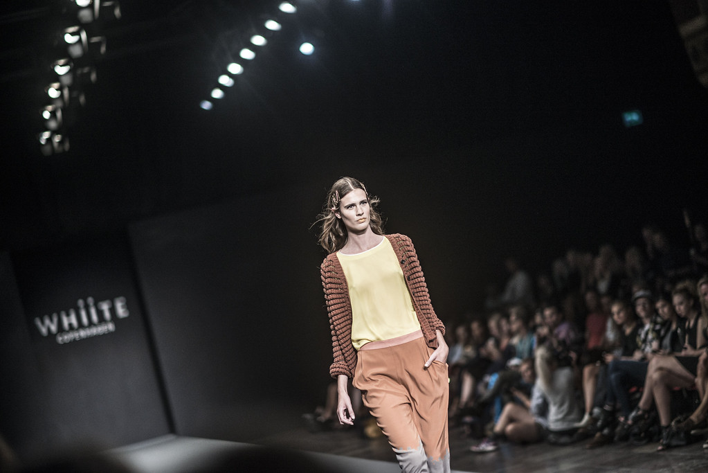 . A model wears an outfit during the Whiite show during Copenhagen Fashion Week Spring/Summer 2014 in Copenhagen on Wednesday, Aug. 7, 2013. (AP Photo/POLFOTO, Anthon Unger)