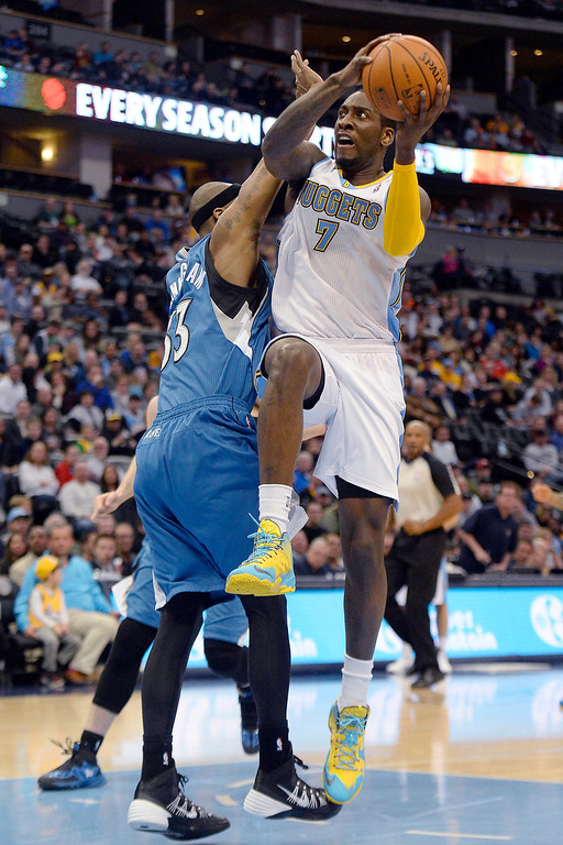 . Dante Cunningham (33) of the Minnesota Timberwolves defends J.J. Hickson (7) of the Denver Nuggets during the first quarter at the Pepsi Center.  (Photo By AAron Ontiveroz/The Denver Post)