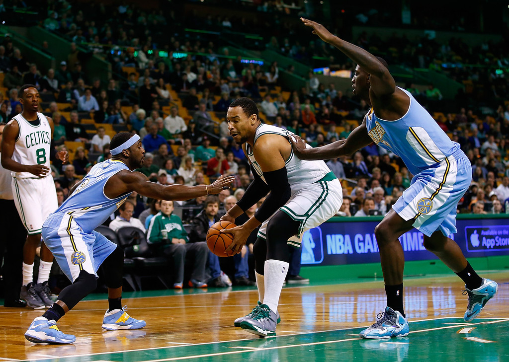 . BOSTON, MA - DECEMBER 06: Jared Sullinger #7 of the Boston Celtics drives to the basket in front of Ty Lawson #3 of the Denver Nuggets in the first quarter during the game at TD Garden on December 6, 2013 in Boston, Massachusetts.  (Photo by Jared Wickerham/Getty Images)