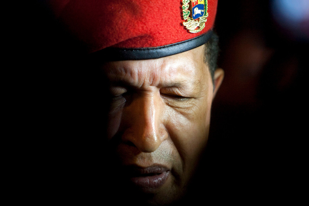 . Venezuela\'s President Hugo Chavez arrives at the international airport in Cancun in this February 21, 2010 file photo. Chavez has died after a two-year   battle with cancer, ending the socialist leader\'s 14-year rule of the South American country, Vice President Nicolas Maduro said in a televised speech on March 5, 2013.   REUTERS/Gerardo Garcia/Files