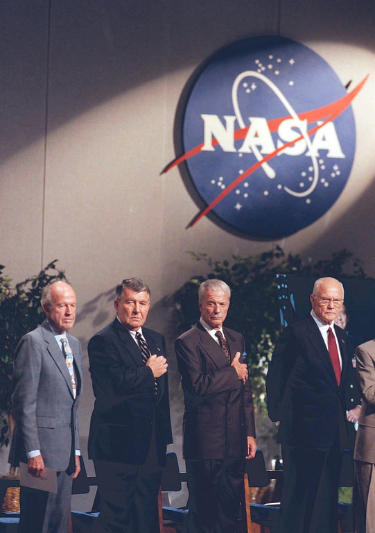 ". The last remaining four of the original ""Mercury Seven,\"" from left, Gordon Cooper, Walter Schirra, Scott Carpenter, and John Glenn, stand while the colors are presented during a memorial service for the first American in Space, Alan Shepard, at Johnson Space Center in Houston, Sat. Aug 1, 1998.(AP Photo/Michael Stravato)"