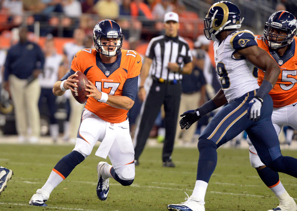 . DENVER, CO. - AUGUST 17: Denver Broncos quarterback Brock Osweiler (17) scrambles out of the pocket during the third quarter August 24, 2013 at Sports Authority Field at Mile High. (Photo By John Leyba/The Denver Post)