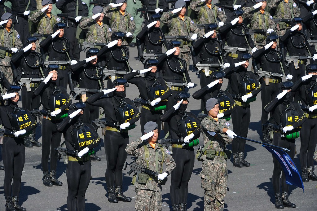. South Korean UDT-SEAL troops salute the national flag of Korea at Seoul Air Base during the 65th anniversary of the Republic of Korea armed Forces day on September 27, 2013.  AFP PHOTO / KIM DOO-HO/AFP/Getty Images