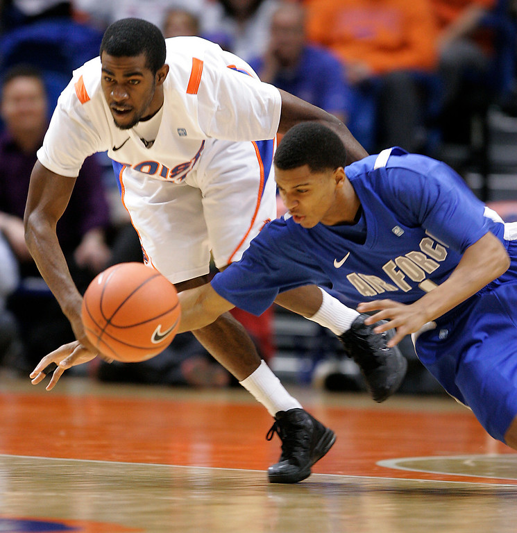 . Air Force\'s Tre\' Coggins, right, and Boise State\'s Michael Thompson go after a loose ball during the second half of an NCAA college basketball game, Wednesday, Feb. 20, 2013, in Boise, Idaho. BSU won 77-65. (AP Photo/Matt Cilley)