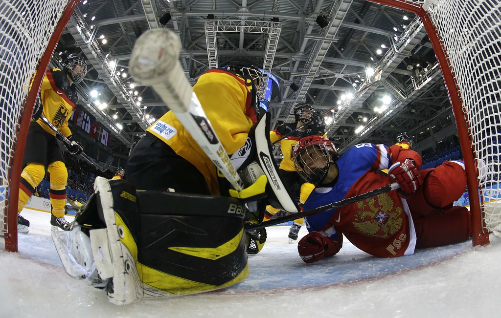 . Germany\'s goalkeeper Vionna Harrer saves a shot during the Women\'s Ice Hockey Group B match Russia vs Germany at the Shayba Arena during the Sochi Winter Olympics on February 9, 2014. JIM YOUNG/AFP/Getty Images