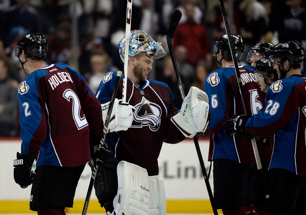 . Goalie Semyon Varlamov (1) of the Colorado Avalanche celebrates after winning 4 to 2 over the Wild.  The Colorado Avalanche hosted the Minnesota Wild in the first round of the Stanley Cup Playoffs at the Pepsi Center in Denver, Colorado on Saturday, April 19, 2014. (Photo by John Leyba/The Denver Post)