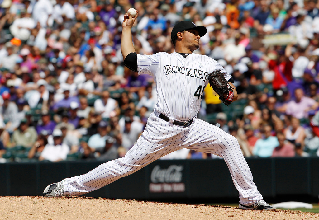 . Colorado Rockies starting pitcher Jhoulys Chacin works against the Philadelphia Phillies in the fifth inning of a baseball game in Denver on Sunday, June 16, 2013. (AP Photo/David Zalubowski)