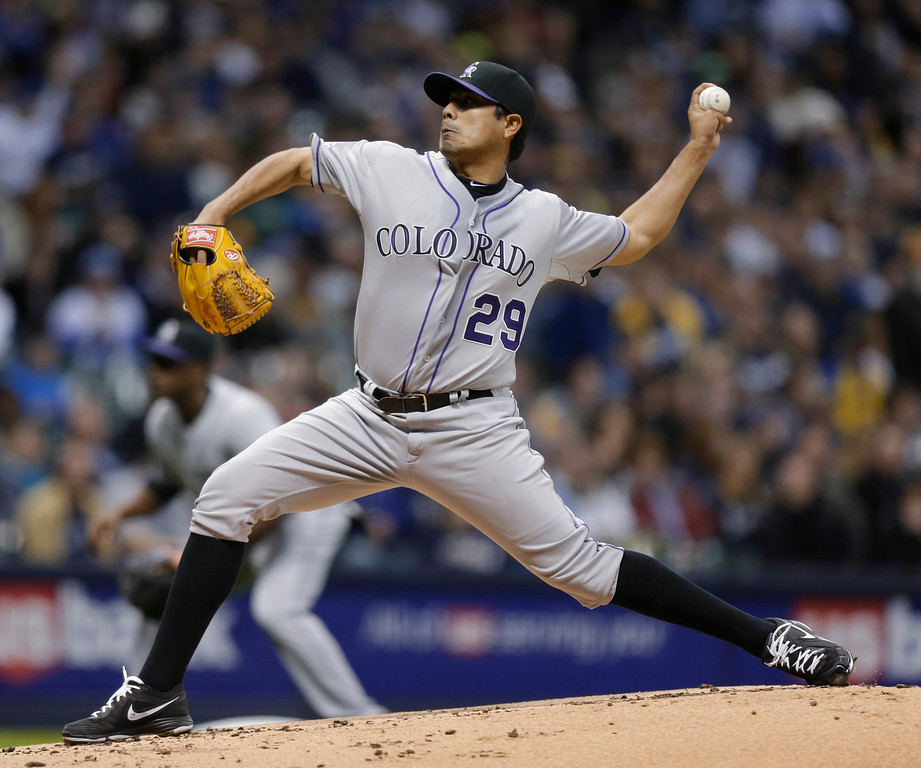 . Colorado Rockies starting pitcher Jorge De La Rosa throws to the Milwaukee Brewers during the first inning of a baseball game Tuesday, April 2, 2013, in Milwaukee. (AP Photo/Jeffrey Phelps)