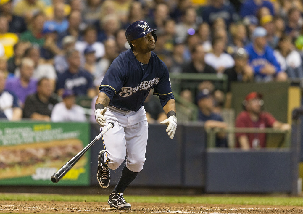 . Khris Davis #18 of the Milwaukee Brewers hits an RBI sacrifice fly against the Colorado Rockies at Miller Park on June 26, 2014 in Milwaukee, Wisconsin.  (Photo by Tom Lynn/Getty Images)