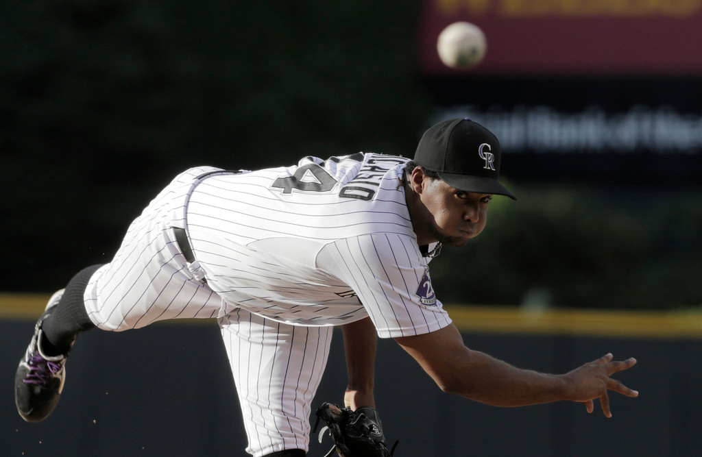 . Colorado Rockies starting pitcher Juan Nacasio throws in the first inning of a baseball game against the Philadelphia Phillies, Friday, June 14, 2013, in Denver. (AP Photo/Joe Mahoney)