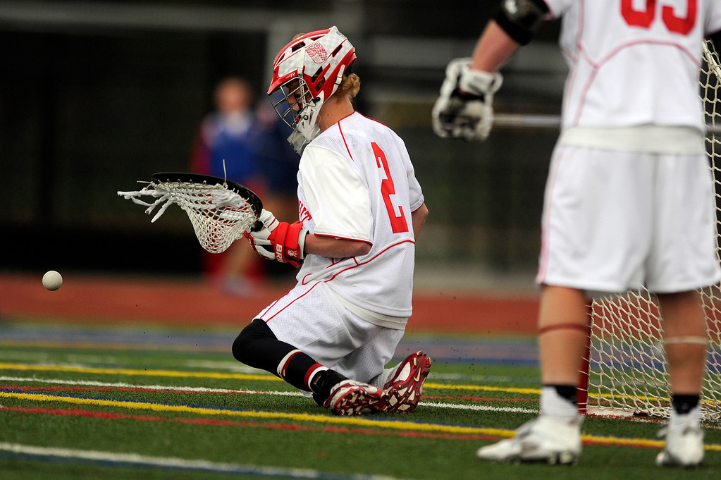 . DENVER, CO - MAY 15: Regis Jesuit sophomore goalie Bret Quartuccio #2 makes a save against Arapahoe High School a CHSAA 5A boys lacrosse semifinal on May 15, 2013, in Denver, Colorado. Arapahoe won 13-5 to advance to the finals. (Photo by Daniel Petty/The Denver Post)