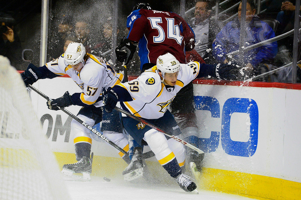 . Roman Josi (59) of the Nashville Predators and Gabriel Bourque (57) check David Jones (54) of the Colorado Avalanche during the first period of action. The Colorado Avalanche take on the Nashville Predators at the Pepsi Center on February 18, 2013. (Photo By AAron Ontiveroz/The Denver Post)