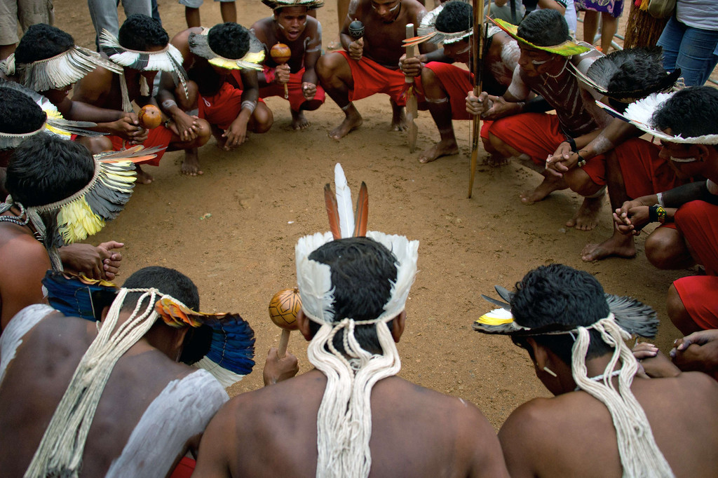 . Brazilian indigenous men of the Kariri Xoco tribe pray before the bow and arrow competition during the XII International Games of Indigenous Peoples in Cuiaba, Mato Grosso state, Brazil on November 12, 2013. AFP PHOTO / Christophe SIMON/AFP/Getty Images