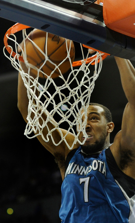 . Wolves forward Derrick Williams (7) jammed the ball through the rim following an offensive rebound in the first half. The Denver Nuggets hosted the Minnesota Timberwolves at the Pepsi Center Thursday night, January 3, 2013. Karl Gehring/The Denver Post