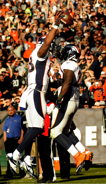 . Wide receiver Demaryius Thomas (88) celebrates his score with running back Montee Ball (28) that broke the season passing yardage record against the Oakland Raiders at O.co Coliseum December 29, 2013 Oakland, CA. (Photo By Joe Amon/The Denver Post)