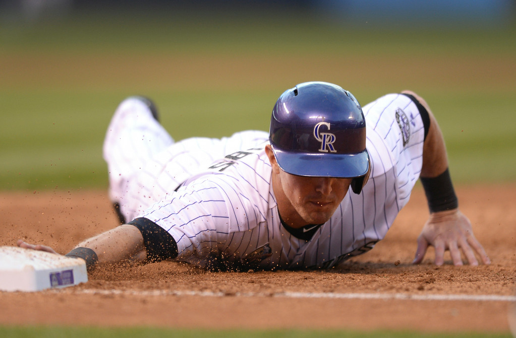. DENVER, CO - JULY 4: Colorado baserunner Drew Stubbs dived back to the bag after Dodgers starter Clayton Kershaw tried to pick him off first. The Colorado Rockies hosted the Los Angeles Dodgers at Coors Field Friday night, July 4, 2014.  Photo by Karl Gehring/The Denver Post
