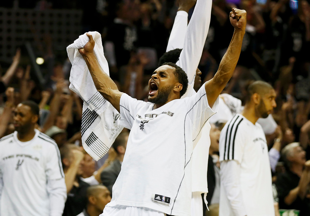 . San Antonio Spurs\' Patty Mills celebrates during play against the Miami Heat during the fourth quarter of Game 3 of their NBA Finals basketball playoff in San Antonio, Texas June 11, 2013. REUTERS/Lucy Nicholson
