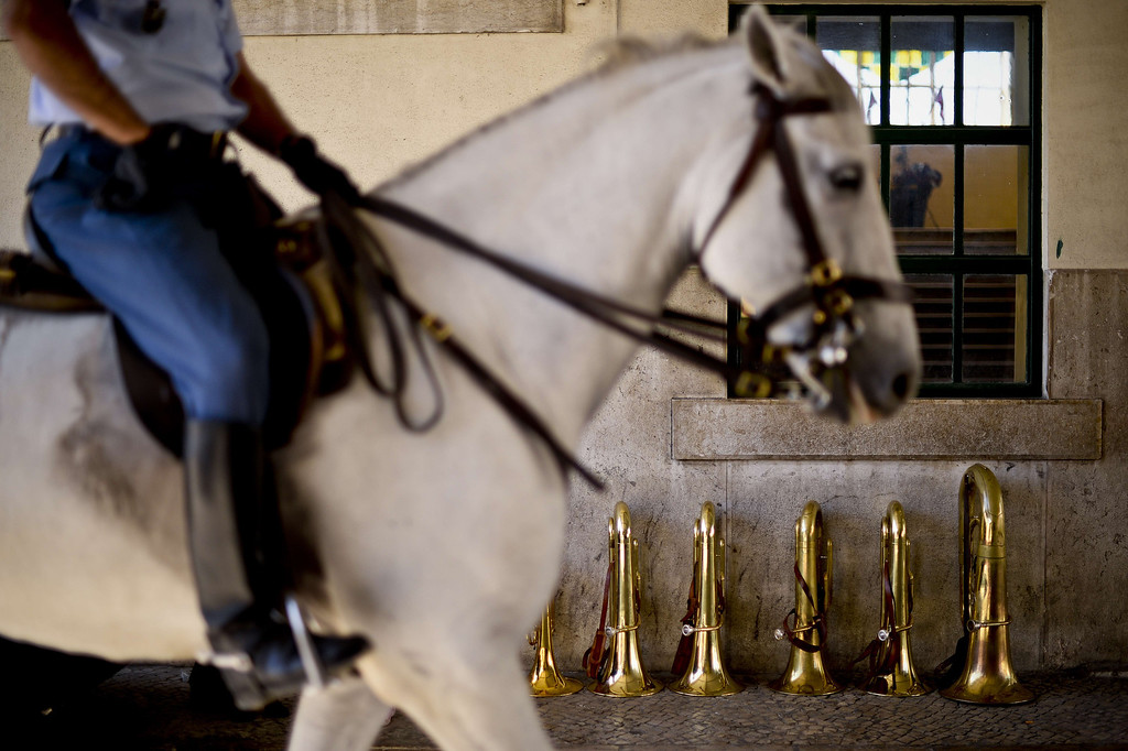 . A cavalryman rides past instruments after taking part in a training session at the National Guard\'s third squad facilities at Braco de Prata in Lisbon, on August 16, 2013. The cavalry of Portugal\'s National Guard has a unique mounted brass band which was created in 1942. It features various instruments including cavalry trumpets, flugelhorn and kettledrum. The cavalry, which consists of 130 white or piebald horses and 27 riders, take part in various official ceremonies and touristic events, including the Change of Guards at Belem\'s National Palace.   PATRICIA DE MELO MOREIRA/AFP/Getty Images