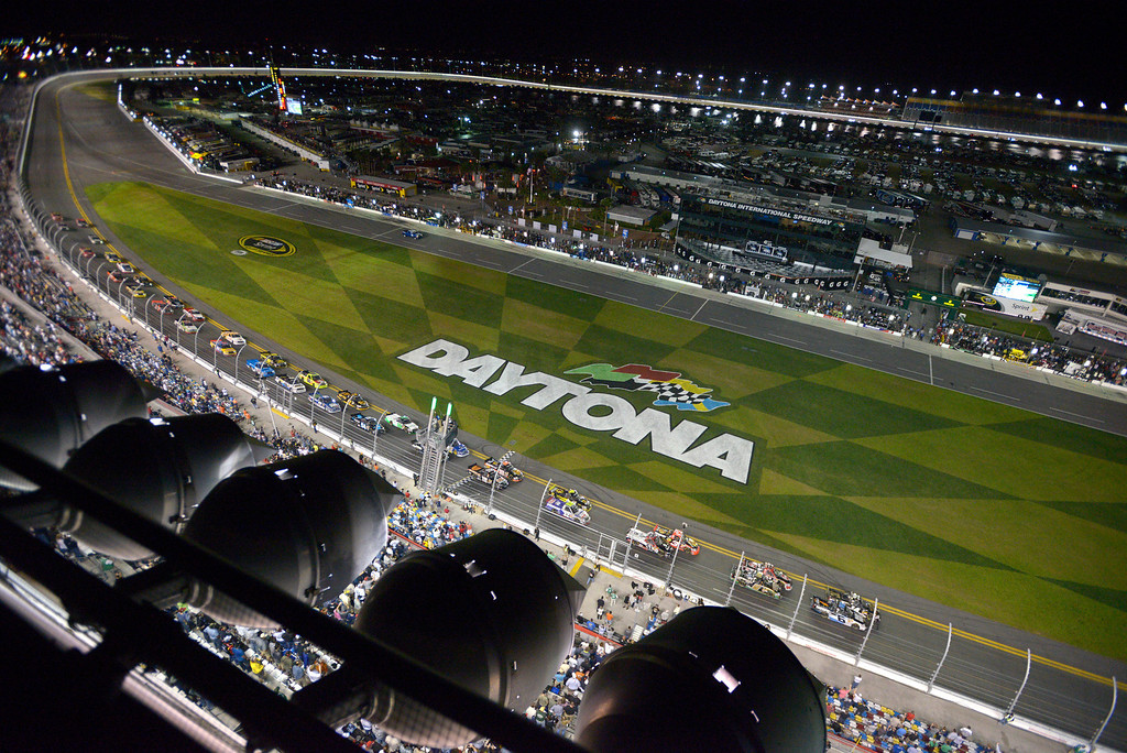 . Brennan Newberry (14) and Justin Lofton (6) lead the pack of racers to the green flag for the start of the NASCAR Truck Series auto race at Daytona International Speedway in Daytona Beach, Fla., Friday, Feb. 22, 2013. (AP Photo/Phelan M. Ebenhack)