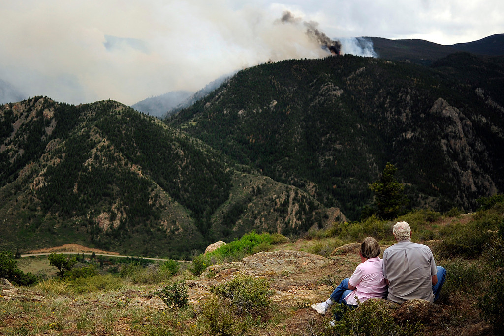 . Art and Carrol Newburn watch as the High Park fire burns on Stove Prairie Road and Highway 14 in Poudre Canyon west of Fort Collins on Tuesday, June 12, 2012. The fire has now burned more than 40,000 acres encompassing more than 65 square miles. AAron Ontiveroz, The Denver Post