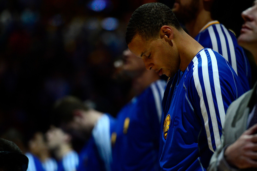 . DENVER, CO. - APRIL 20: Golden State Warriors point guard Stephen Curry (30) bows his head during the National anthem before the start of the game. The Denver Nuggets took on the Golden State Warriors in Game 1 of the Western Conference First Round Series at the Pepsi Center in Denver, Colo. on April 20, 2013. (Photo by AAron Ontiveroz/The Denver Post)